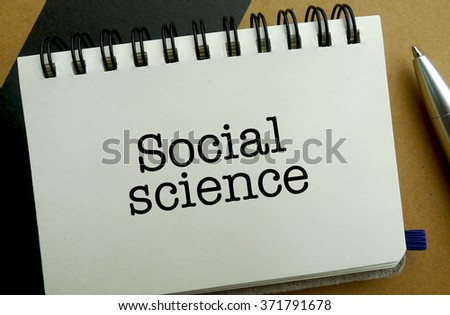 Social science memo written on a notebook with pen