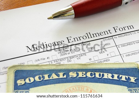 Social Security card and Medicare enrollment form - stock photo