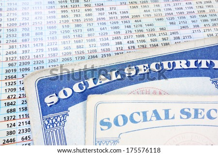 Social Security cards and a sheet of budget numbers