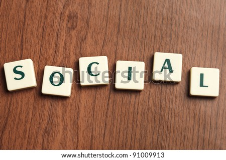 Social word made by letter pieces - stock photo