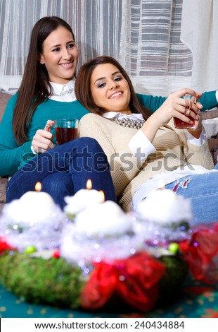 socializing friend for Christmas with a cup of tea/Christmas drinking a cup of hot tea - stock photo