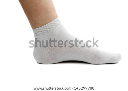Sock and foot. Isolated. A white background. - stock photo