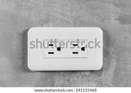Socket, electrical outlet on gray wall. Close-up image. - stock photo