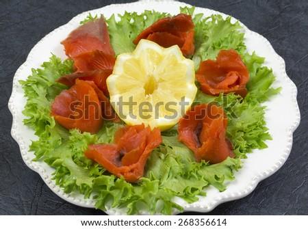 Sockeye salmon on salad leaves - stock photo