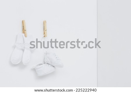 Socks and booties against white background - stock photo