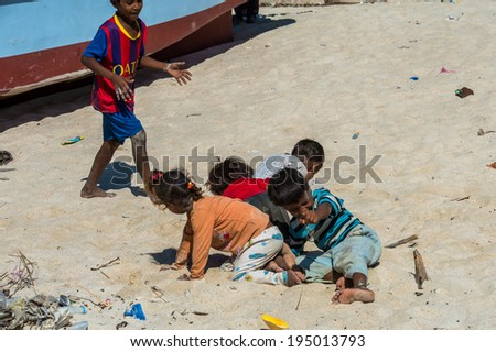 SOCOTRA, YEMEN - JAN 12, 2014: Unidentified Yemeni children play on the beach of the Island of Socotra. Children in Socotra live in poverty and grow without education