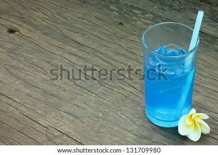 Soda drinks with blue flowers - stock photo