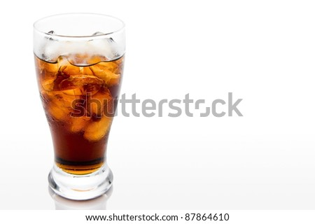 Soda in a glass with white background - stock photo