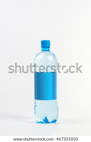 Soda water bottle with blank label.  Crystal clear water on white background in a blue bottle. Perfect for advertising drink and their logo.