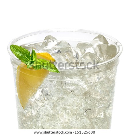 Soda with ice and slice of lemon and mint in takeaway cup on white background - stock photo