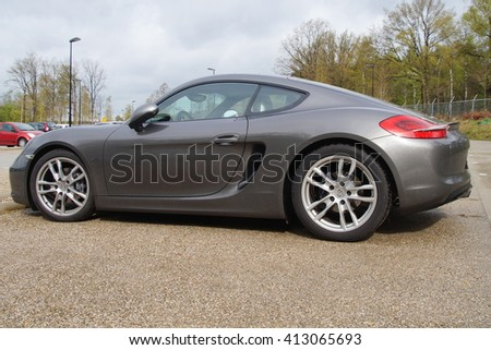 Soest, The Netherlands - April 29, 2016: Gray Porsche 981 cayman coupe parked on a public parking lot in the city of Soest.