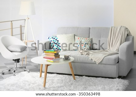 Sofa and armchair in living room - stock photo