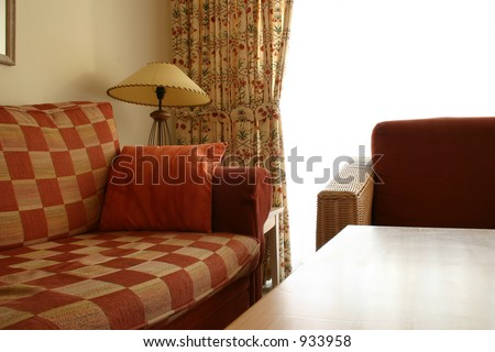 sofa and table of an interior of a apartment - stock photo