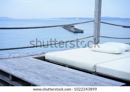 https://thumb1.shutterstock.com/display_pic_with_logo/167494286/1022243899/stock-photo-sofa-by-the-sea-1022243899.jpg