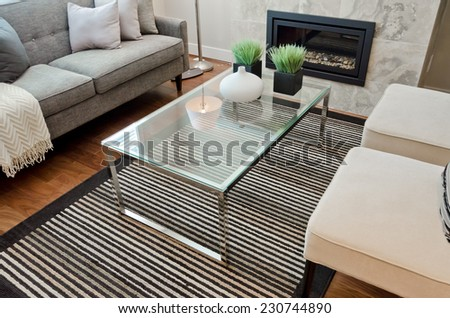 Sofa, couch with some pillows, nicely decorated coffee table and two chairs. Fragment of living room.  Interior design. - stock photo