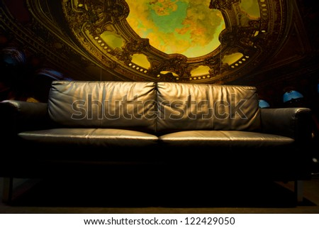 sofa in a dark room