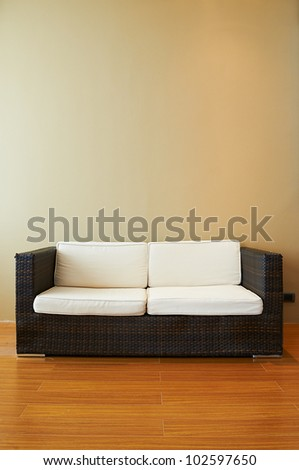 Sofa in empty living room - stock photo