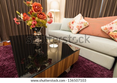 Sofa in living room with decorative flower