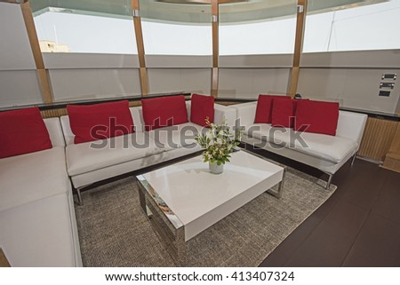 Sofa in salon area of a large luxury motor yacht - stock photo