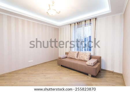 Sofa in the interior, a large spacious room.. Modern interior room with nice furniture inside - stock photo