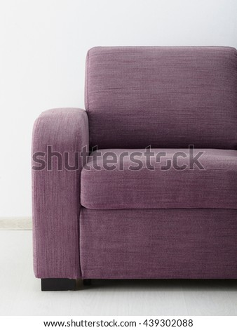 Sofa in white room. Close-up