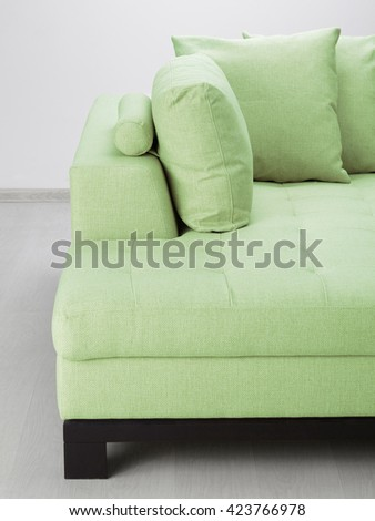 Sofa isolated against the wall - stock photo