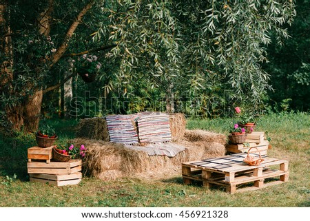 sofa made from straw, outdoor furniture, cowboy party. wooden of a pallet - stock photo