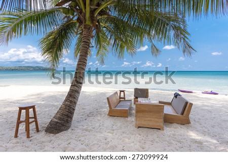 "Sofa on white sand beach. Shadow from the coconut trees. Kood island,Thailand,Kood island is the most beautiful island in eastern thailand,In thai people call ""Koh kood"" - stock photo"