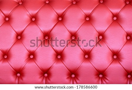Sofa pink background with light reflection. - stock photo
