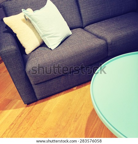 Sofa with cushions and green coffee table. Living room detail. - stock photo