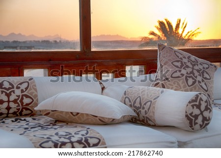 Sofa with Cushions near Window with Sunset View of Hurghada, Egypt