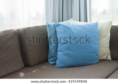 Sofa with pillows in room at home. - stock photo