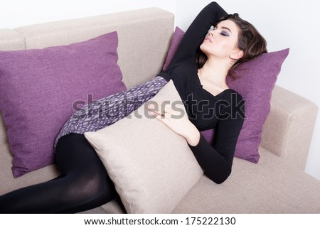 Sofa Woman relaxing enjoying luxury lifestyle outdoor day dreaming and thinking looking happy up smiling cheerful. Beautiful young multicultural Asian Caucasian female model in her 20s.  - stock photo