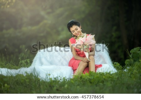 Sofa Woman relaxing enjoying luxury lifestyle outdoor day dreaming and thinking looking happy up smiling cheerful. - stock photo