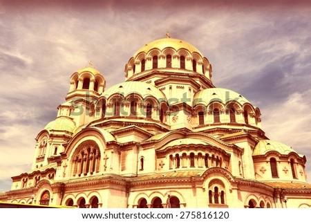 Sofia, Bulgaria - Alexander Nevsky Orthodox Cathedral. Neo-Byzantine architecture. Oborishte district. Cross processing color tone - filtered retro style. - stock photo