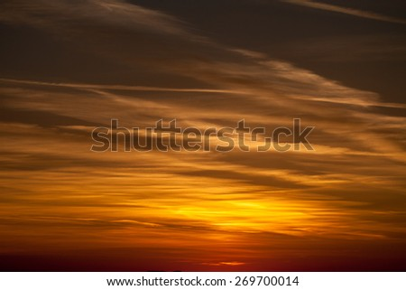 Sofia, Bulgaria - 15 April, 2015: Outdoor sun rays through blurred dark vivid sunset cloud atmospheric volumes over the residential district of Gorna Banya in the west of Sofia - stock photo