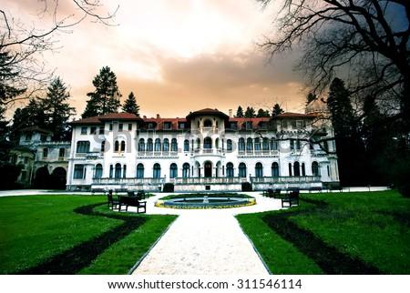 SOFIA, BULGARIA- AUGUST 31, 2015 : Dramatic HDR sunset over the bulgarian king Simeon 2 residence in Vrana park in Sofia, Bulgaria - stock photo