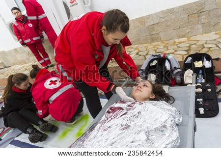 Sofia, Bulgaria - December 5, 2014: Members from Bulgarian Red Cross Youth (BRCY) voluntary youth organization are participating in a training simulation of a natural disaster situation. - stock photo