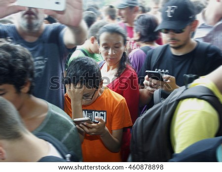 Sofia, Bulgaria - July 30, 2016: Young people  playing with their mobile phones to the Pokemon game