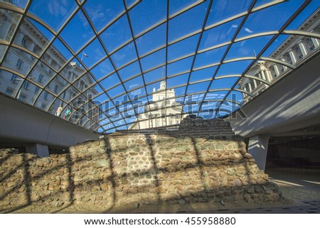 Sofia, Bulgaria - Jun 28 , 2016: The building of the Bulgatian Parliament is visible through anciant wall of the old city of Serdika