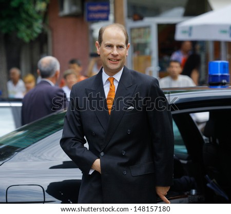 "SOFIA, BULGARIA - JUNE 24: His Royal Highness The Prince Edward, Earl of Wessex, on a visit at Community Support Center ""St. Sofia"" to meet with children at risk in Sofia, Bulgaria - June 24, 2013 .  - stock photo"