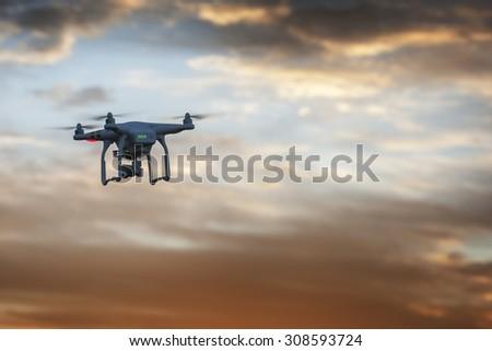 SOFIA, BULGARIA - JUNE 22, 2015: Image of the phantom 3 professional quadcopter flies against a beautiful sunset in the background on the June 22, 2015 ,Sofia, Bulgaria. - stock photo