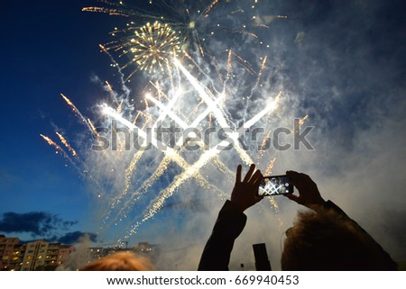 Sofia, Bulgaria - June 8, 2017: Man taking pictures of fireworks in the evening sky.Illustrative editorial