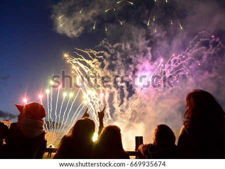 Sofia, Bulgaria - June 8, 2017: People watch fireworks in the evening sky.Illustrative editorial