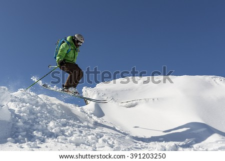 Sofia, Bulgaria - March 12, 2016: Freestyle skier is jumping from the top of a peak of Vitosha mountain. He is participating in an freestyle competition of skiers and snowboarders during the weekend. - stock photo