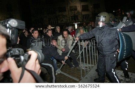 SOFIA, BULGARIA - NOVEMBER 12: Protesters scuffle with police forces during a demonstration near the parliament, November 12, 2013, Sofia, Bulgaria. - stock photo