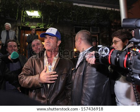 "SOFIA, BULGARIA - OCTOBER 4, 2013. Mel Gibson arrives at Sofia airport for the shooting of ""The Expendables 3"". The filming of the production in Bulgaria will continue till the end of October.      - stock photo"
