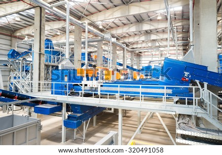 Sofia, Bulgaria, September 14, 2015 - Conveyor belts and pipes for disposing and processing compost, the final form of recycled waste in a recycling waste to energy and composting factory.