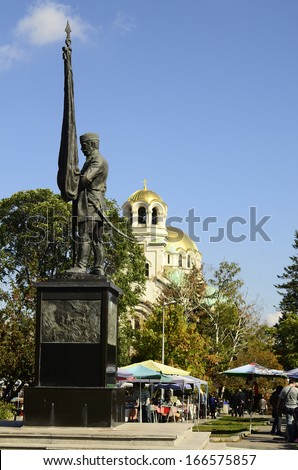 SOFIA, BULGARIA - SEPTEMBER 28: Monument of the Bulgarian volunteers and unidentified people on second hand street market in front of the Alexander Newski cathedral, on September 28, 2013 in Sofia, BG
