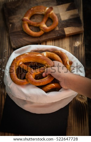 Soft and warm pretzels in a cloth bag
